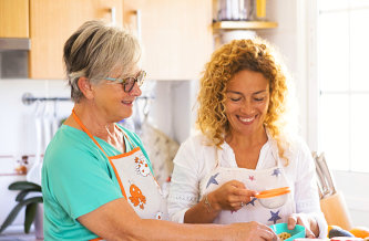 a caregiver and a senior cooking