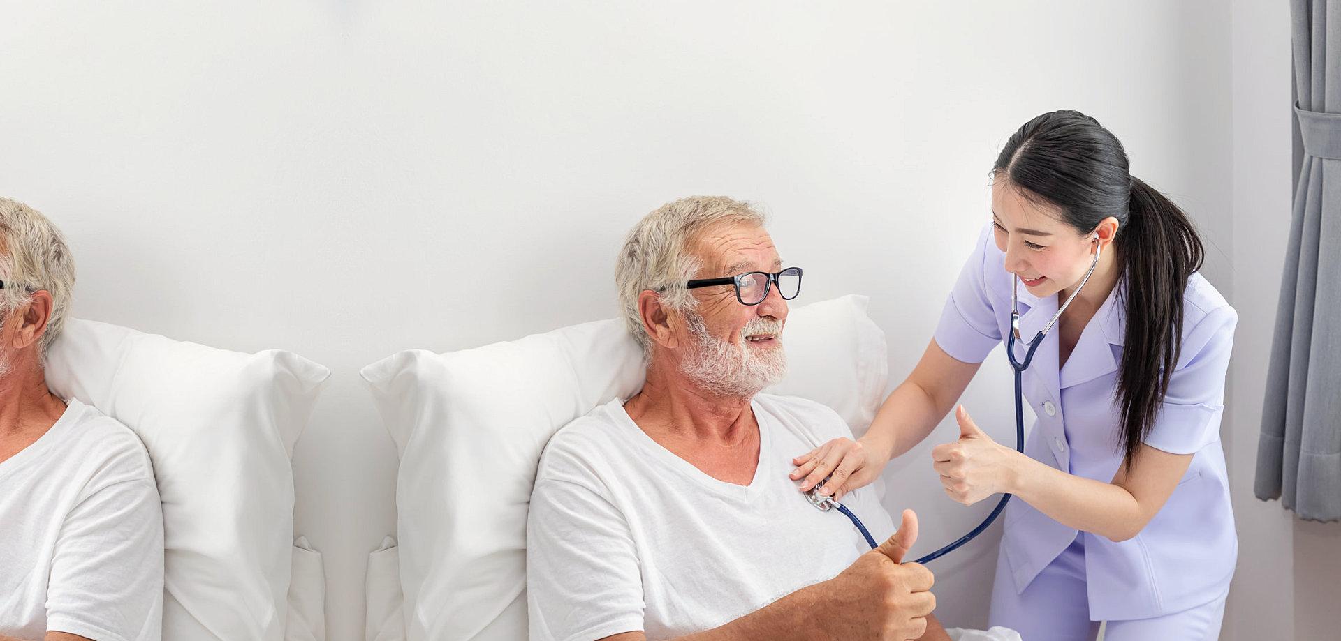 a caregiver checking the blood pressure of a senior man
