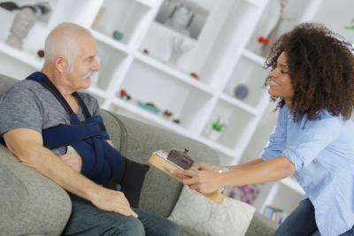 caregiver giving senior man his meal