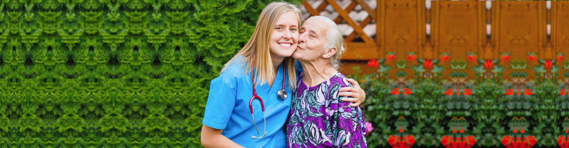 senior woman kissing female caregiver's cheek