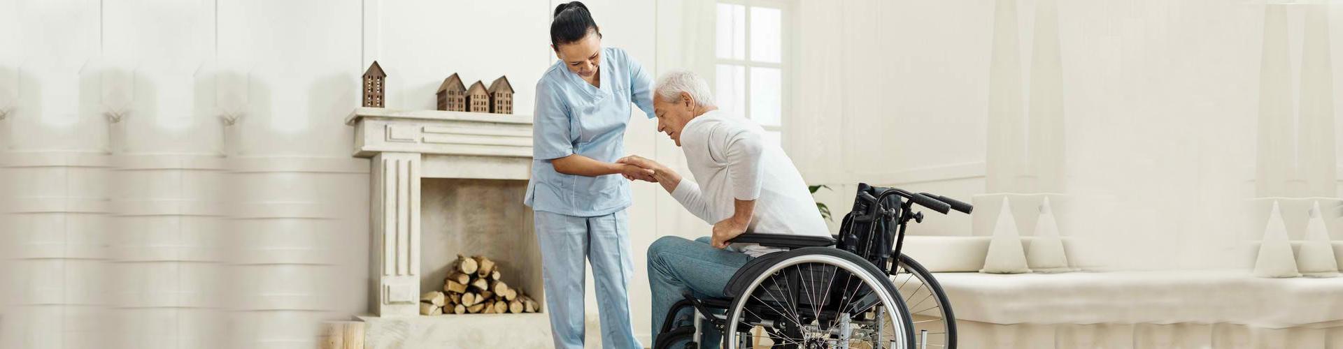 a caregiver helping a senior man stand